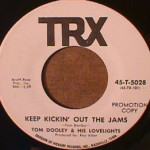 Tom Dooley / Lovelights - Keep Kickin' Out The Jams / Plastic Saddle